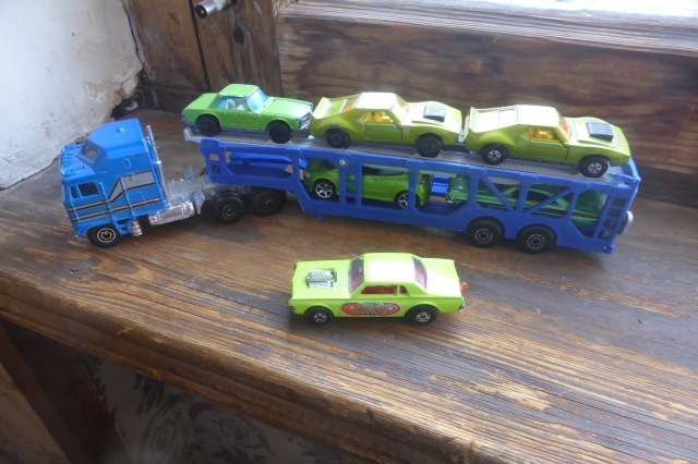 green cars on a transporter