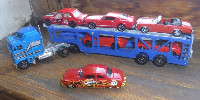 red cars on a transporter 2