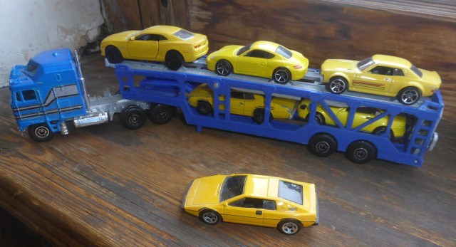 yellow cars on a transporter 2
